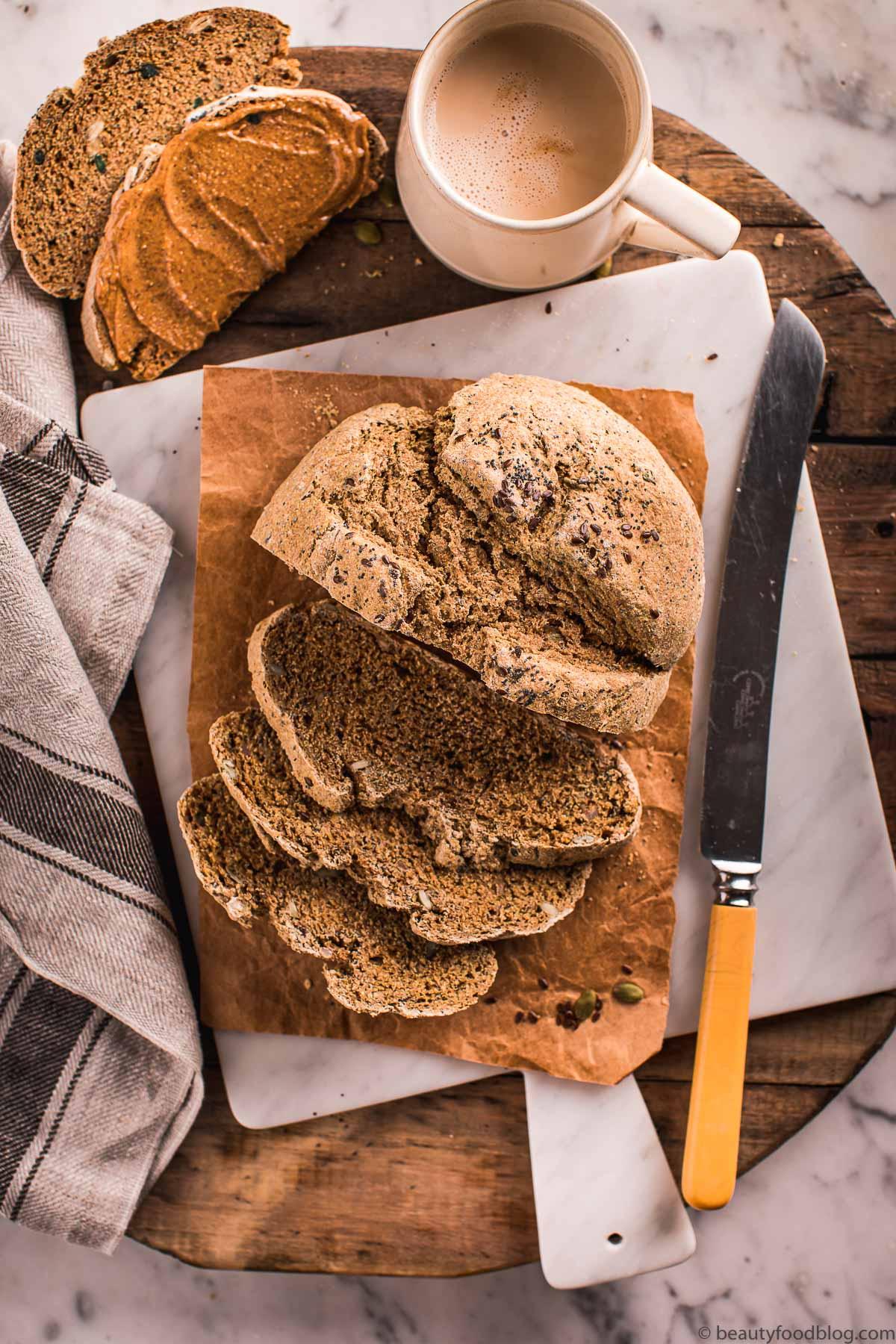tagliere con pane senz lievito coltello e tazza di caffelatte wood board with soda bead and a coffee cup